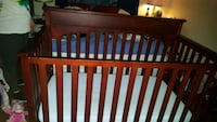 Used convertible crib with cherry wood stain Houston, 77024