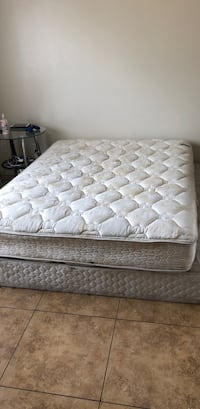 Quilted white mattress with brown wooden bed frame Tucson, 85706