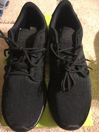 pair of black low top sneakers with box