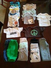 baby's assorted clothes 176 mi