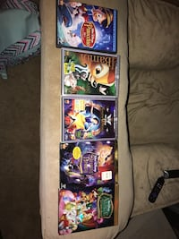 Five assorted movie dvd cases