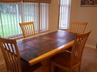 rectangular brown wooden table with four chairs dining set Orlando, 32837