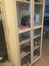 Tall wooden cabinet with two glass doors  North Las Vegas, 89032