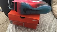 red-and-black Nike athletic shoes with red box