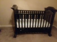 baby's brown wooden crib Kansas City, 64136