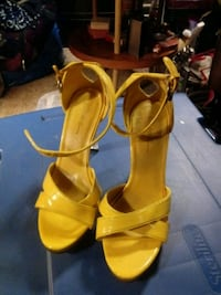 Woman's yellow and clear heels.