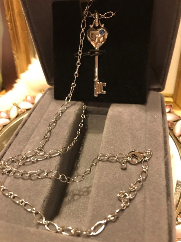 Pretty! Silver Heart Key Necklace with tiny blue Crystal Stone a3f26c8a-daf9-4c57-8734-1bd09f2404aa