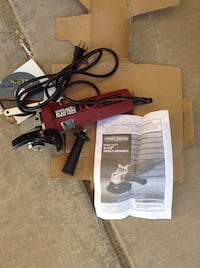 black and gray corded power tool 2051 mi