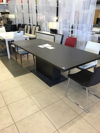 Extendable dining table made in Italy.