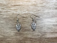 Pair of silver-colored hook earrings