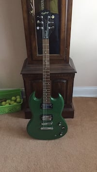 green and black electric guitar Bowie, 20715
