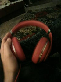 red and black corded headphones