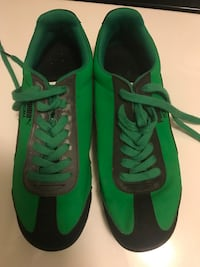 Green and black puma sneakers.  Men's 9.5 Dayton, 45410