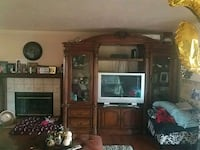 brown wooden TV hutch with flat screen television Sacramento, 95823