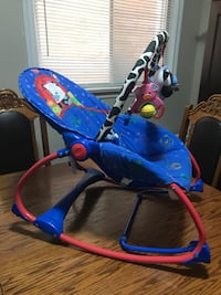 Baby's blue and red rocking and vibrating chair Toronto, M6E 4E3