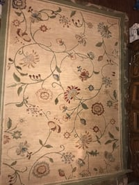 beige and black floral area rug Rockville, 20852