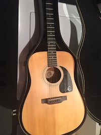 Natural finish Ephiphone acoustic guitar with black case