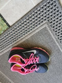 pair of black-and-pink Nike running shoes Edmonton, T6P 0A4