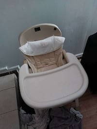 toddler's beige feeding high chair with tray