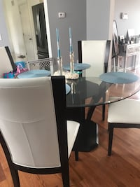 Round glass top table with four chairs dining set Toms River, 08757