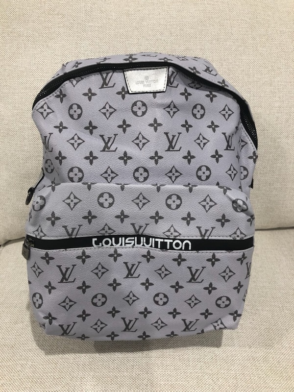 c0cdcf51e71e Used gray and black monogrammed MCM leather backpack for sale in West Palm  Beach
