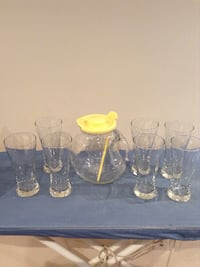 7 tall beer glasses and drink pitcher