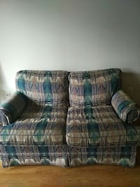 green and brown fabric loveseat