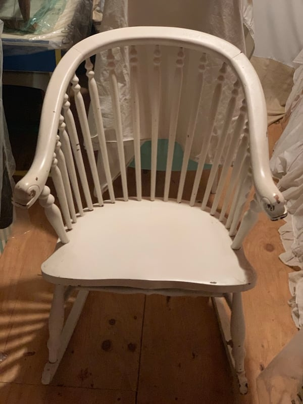 """VINTAGE ROCKING CHAIR! roughly 40"""" tall. Comes with blue and white cushion as seen in 3rd picture. Very sturdy!! 77518db9-8a6c-4237-be9a-af07595af4f4"""
