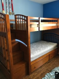 Brown wooden bunk bed with mattresses Richmond Hill, L4C