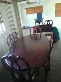 Table with 6 chairs, leaf, and cover matts. Orlando, 32806