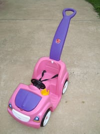 Pink and purple plastic ride on toy