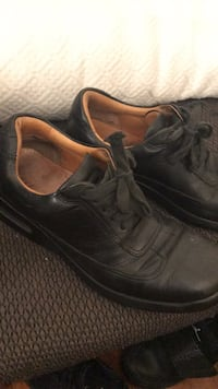Pair of black leather shoes 193 km