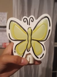 white and yellow butterfly toy
