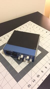 black and blue Audiobox amplifier