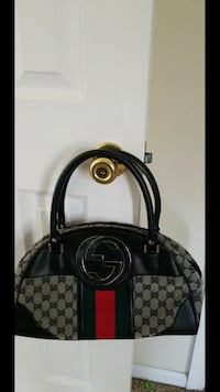 Black and grey gucci monogrammed leather tote bag