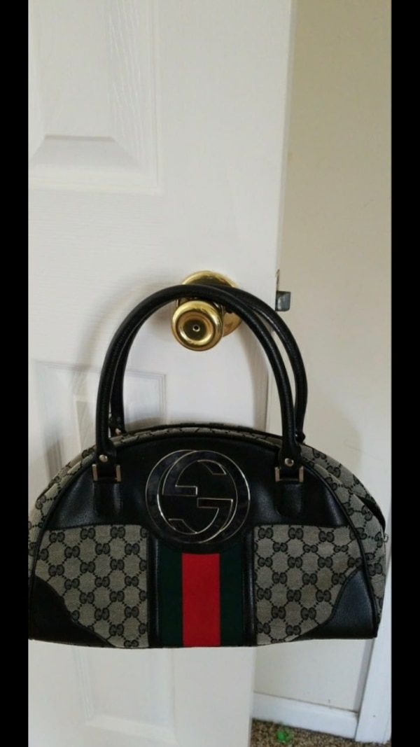 Black and grey gucci monogrammed leather tote bag 0d6af487-e132-43bb-af86-49020475191e