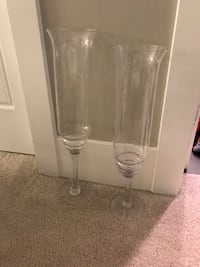 Two clear glass footed vases