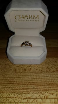 gold-colored Charm ring with box