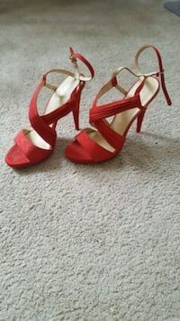pair of red open-toe ankle strap heels 48 km