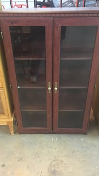 brown wooden framed glass cabinet Rockdale, 60436