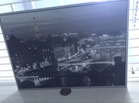 black framed painting of Eiffel Tower Miami, 33131