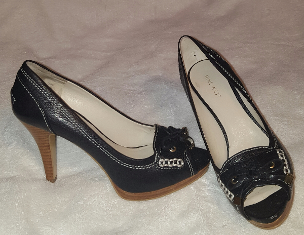 women's pair of black and brown peep toe stilettos Accokeek