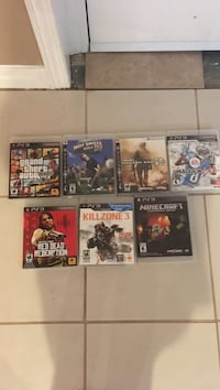 six Sony PS3 game cases