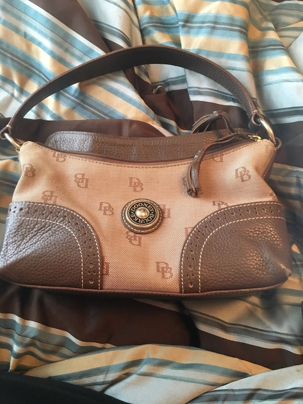brown monogrammed Dooney and Bourke leather hobo bag
