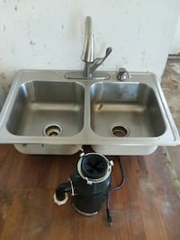 Sink with faucets and garbage disposal