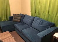 Blue fabric sectional sofa with throw pillows