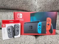 Nintendo Switch unopened with extra controllers.