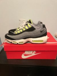 pair of gray-green-and-black Nike shoes with box