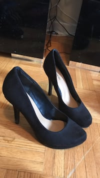 Women's pair of black platform stilettos