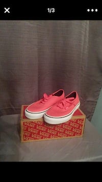 pair of pink-and-white Vans low-top sneakers with box